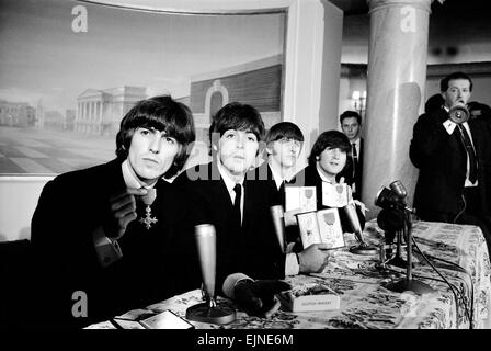 The Beatles pose with their MBEs at a press conference held at the Saville Theatre, London, following their investiture - Stock Photo