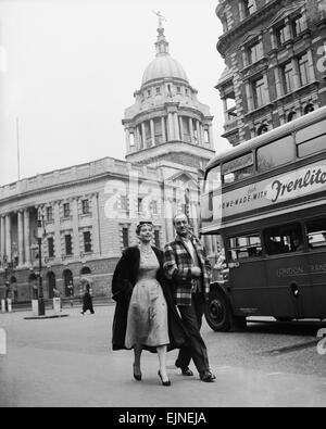 Actor David Niven with French actress Genevieve Page walking through London during a break from filming on their - Stock Photo