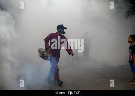 Mosquito fogging is held in suburban area of Kebon Jeruk, a sub-district in West Jakarta, as fight against dengue - Stock Photo