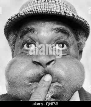 American jazz musician Dizzy Gillespie puffing out his cheeks during a visit to Middlesbrough, where he played at - Stock Photo