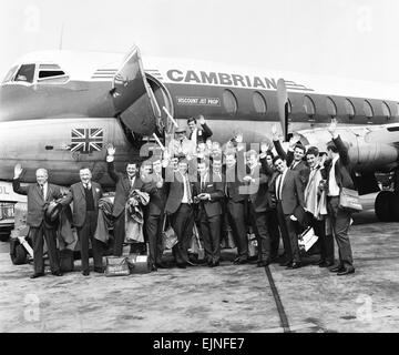 Everton team members wave before their plane bound for Australia departs from Speke airport, Liverpool. 28th April - Stock Photo