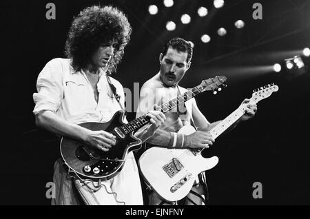 Rock group Queen in concert at Wembley Arena. Lead singer Freddie Mercury performing on his 38th birthday on stage - Stock Photo