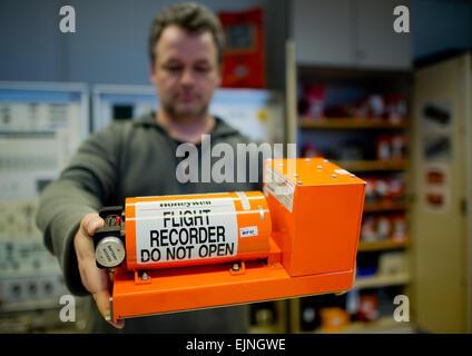 Braunschweig, Germany. 30th Mar, 2015. Jens Friedmann shows a flight recorder at the German Federal Bureau of Aircraft - Stock Photo