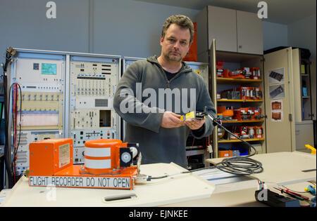 Braunschweig, Germany. 30th Mar, 2015. Jens Friedemann shows a flight recorder at the German Federal Bureau of Aircraft - Stock Photo