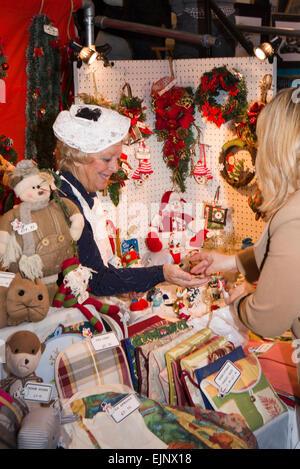 UK, England, Yorkshire, Grassington, Dickensian Festival, stallholder taking money from visitor - Stock Photo