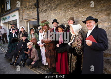 UK, England, Yorkshire, Grassington, Dickensian Festival, group of visitors in Victorian costume - Stock Photo