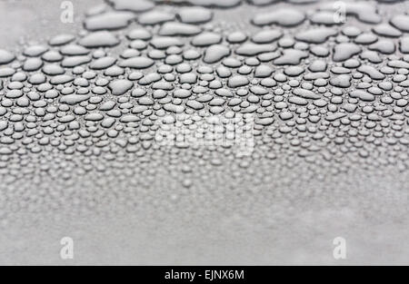Water drops on a metal surface - Stock Photo