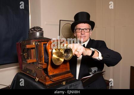 UK, England, Yorkshire, Grassington, Dickensian Festival, Magic Lantern projectionist Andrew Gill - Stock Photo