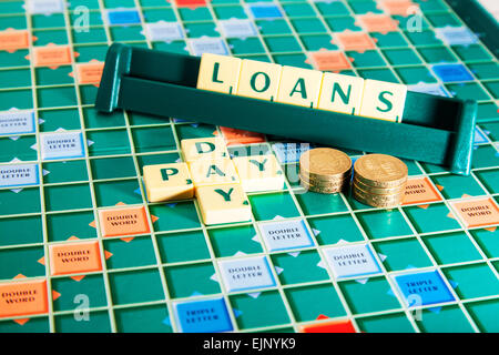 pay day loans loan and money cash wonga lenders lender words using scrabble tiles to illustrate spelling spell out - Stock Photo
