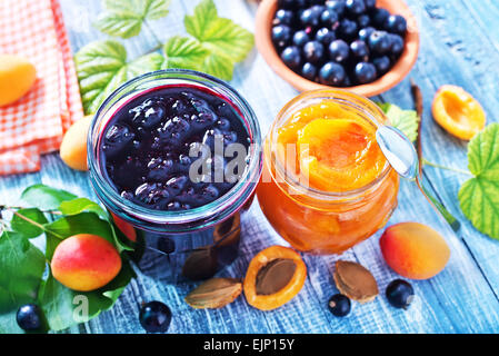 sweet jam in glass bank and on a table - Stock Photo