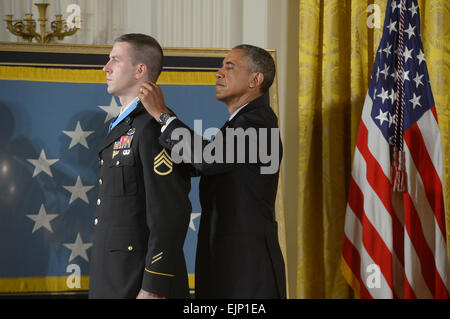 President Barack Obama, right, awards former U.S. Army Staff Sgt. Ryan M. Pitts the Medal of Honor during a ceremony - Stock Photo