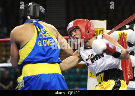 U.S. Army Spc. Adrian Ghisoiu scores with a right uppercut during his 25-8 loss to Adon Ortiz of Sterling, Ill., - Stock Photo