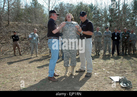 Arkansas Command Sgt. Maj. Deborah Collins reacts to her shocking encounter with a Taser X26 during a demonstration - Stock Photo