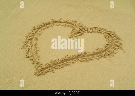 A heart painted in the sand beach - Stock Photo