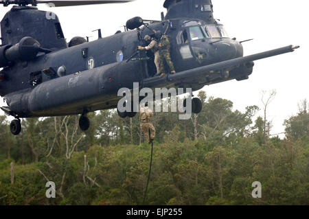A U.S. Air Force Airman fast ropes from an MH-47 Chinook helicopter from an MH-47 Chinook helicopter assigned to U.S. Army 160th Special Operations Aviation Regiment on Fort Fisher in Kure Beach, N.C., Sept. 19, 2007. Airmen and Soldiers from Hurlburt Field, Fla., and Fort Campbell, Ky., participated in the two-week long training.  Airman Matthew R. Loken