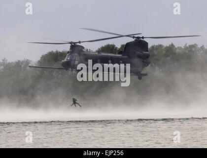 An U.S. Air Force Airman is hoisted from the water by an MH-47 Chinook helicopter from an MH-47 Chinook helicopter assigned to U.S. Army 160th Special Operations Aviation Regiment on Fort Fisher in Kure Beach, N.C., Sept. 19, 2007. Airmen and Soldiers from Hurlburt Field, Fla., and Fort Campbell, Ky., participated in the two-week long training.  Airman Matthew R. Loken