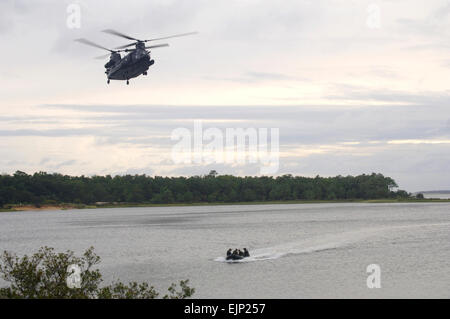 U.S. Air Force special operations Airmen ride in a zodiac boat after jumping from an MH-47 Chinook helicopter from an MH-47 Chinook helicopter assigned to U.S. Army 160th Special Operations Aviation Regiment on Fort Fisher in Kure Beach, N.C., Sept. 19, 2007. Airmen and Soldiers from Hurlburt Field, Fla., and Fort Campbell, Ky., participated in the two-week long training.  Airman Matthew R. Loken