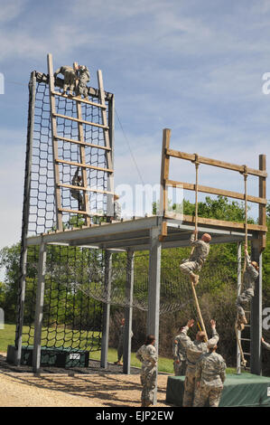 "Cadets from the Black Hawk Brigade struggle through the ""Tough One"" obstacle course April 13 at the ROTC - Stock Photo"