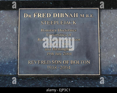 Memorial plaque in the centre of Bolton, which stands in front of the statue Fred Dibnah a famous steeplejack and - Stock Photo