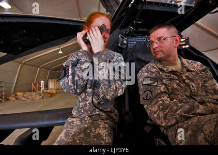 Camp Taji, Iraq, Aug 10, 2009- While going through various components of an AH-64D Apache attack helicopter, 1st - Stock Photo
