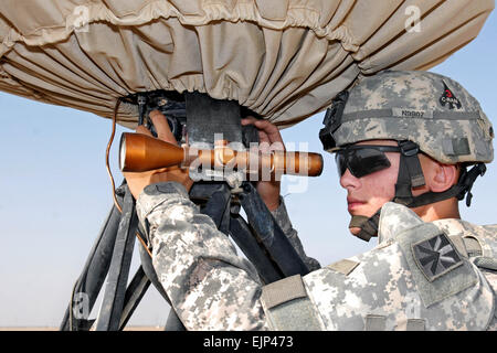 U.S. Army Pfc. Dustin Clark calibrates the sights on a radar system on Contingency Operating Base Basra, Iraq, June - Stock Photo