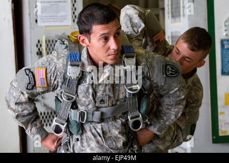 CAMP BONDSTEEL, Kosovo -- After a successful static line airborne jump from a UH-60 Black Hawk, U.S. Army Staff - Stock Photo