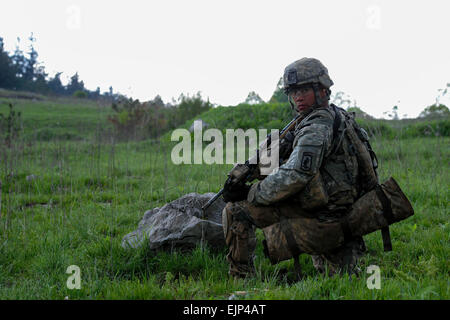 U.S. Army Cpl. Armando D. Butler, a paratrooper assigned to 2nd Battalion, 503rd Infantry Regiment, 173rd Infantry - Stock Photo