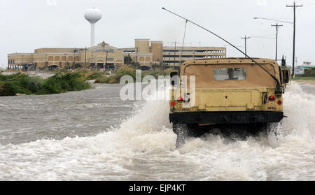Miss. Army National Guard soldiers travel through storm surge to assist Hancock County Sheriff Deputies make contact - Stock Photo