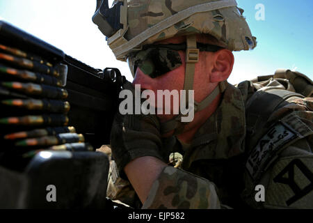 U.S. Army Spc. Christopher Fox, an automatic rifleman attached to Provincial Reconstruction Team Zabul, secures - Stock Photo