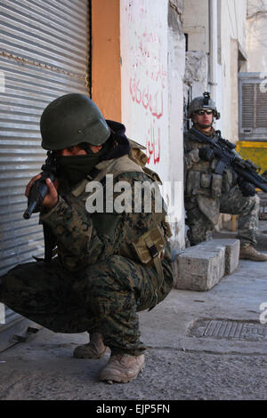 An Iraqi army soldier with the 45th Brigade, 11th Iraqi army division, pulls security on Jan. 8 while on patrol - Stock Photo