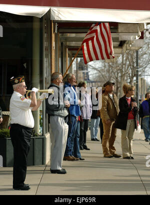 A member of the Veterans of Foreign Wars Post 1273 plays taps before the start of a parade in downtown Rapid City, - Stock Photo