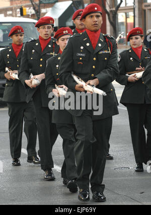 The Central High School Army Junior Reserve Officer Training Corps Drill Team performs during a parade in downtown - Stock Photo