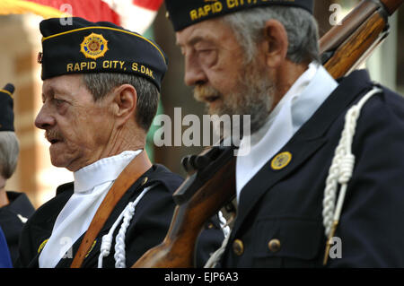 Members of the South Dakota American Legion march during a parade in downtown Rapid City, S.D., Nov. 11, 2007. Rapid - Stock Photo