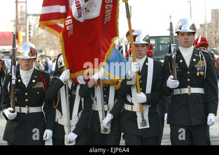 The Central High School Army Junior Reserve Officer Training Corps Color Guard marches during a parade in downtown - Stock Photo