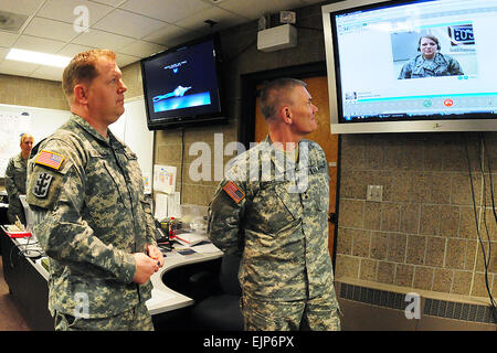 U.S. Army Master Sgt. Traver Silbernagel, left, and Maj. Gen. David Sprynczynatyk, the North Dakota adjutant general, - Stock Photo