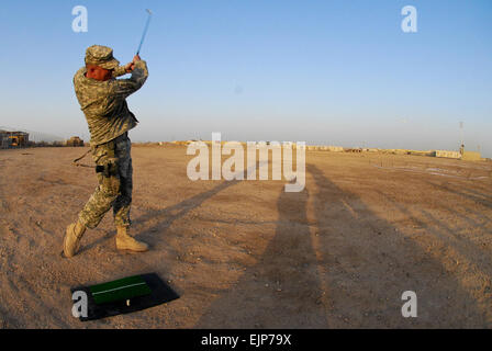 Maj. Jarrod Moreland, 4th Region Department of Border Enforcement, drives a golf ball during the long drive portion - Stock Photo