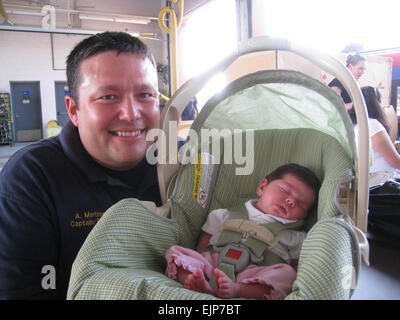 Capt. Adam Martinez and baby Amber Smith pose together for the first time since Amber's arrival into the world April - Stock Photo
