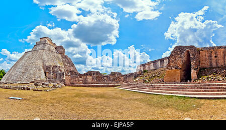 The Pyramid of the Magician is the central structure in the Maya ruin complex of Uxmal, Mexico - Stock Photo