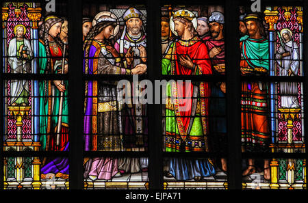 Stained Glass Window depicting the Sacrament of Holy Matrimony, with Pepin of Landen and Itesberga united in marriage. - Stock Photo