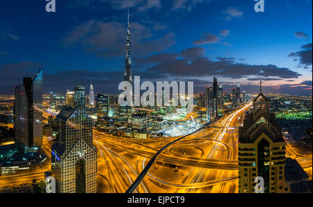Dubai, United Arab Emirates, Burj Khalifa and skyscrapers on Sheikh Zayed Road, evening elevated view - Stock Photo