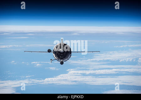 The Russian Soyuz TMA16M spacecraft approaches the International Space Station for docking March 28, 2015 in Earth - Stock Photo
