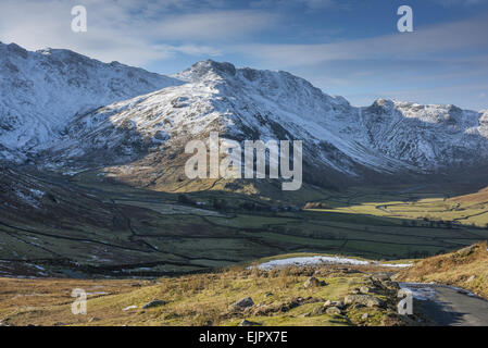 View across valley towards snow covered fell, Langdale Fell, Great Langdale, Lake District N.P., Cumbria, England, - Stock Photo