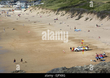 View of sandy beach with RNLI Lifeguards on standby, Fistral Beach, Fistral Bay, Newquay, Cornwall, England, July - Stock Photo