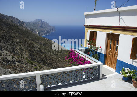 View from mountain village over coastline, Olympos, Karpathos, Dodecanese Islands, Aegean Sea, Greece, July - Stock Photo