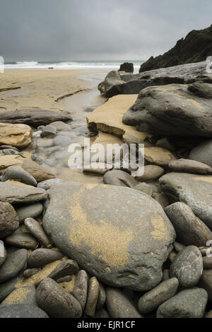 Rocks and pebbles on beach, Coumeenole Beach, Coumeenole North, Dingle Peninsula, County Kerry, Munster, Ireland, - Stock Photo