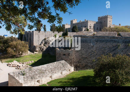 The Byzantine walls and dry moat which surround Rhodes Old Town on the Greek Mediterranean island of Rhodes. - Stock Photo