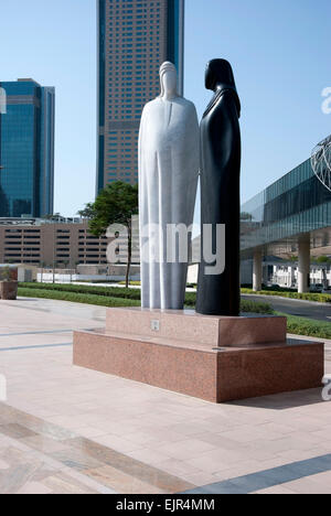 Black & White Granite Sculpture of Arab Man & Woman Together by Lutfi Romhein - Stock Photo