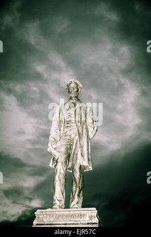 Statue of Abraham Lincoln against cloudy sky in Edinburgh, Scotland of all places. - Stock Photo