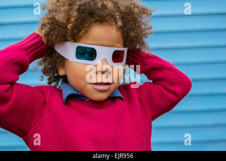 Pacific Islander boy wearing 3D glasses - Stock Photo