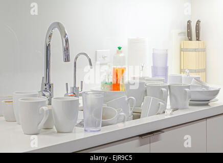 Dirty dishes near kitchen sink - Stock Photo